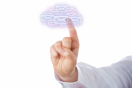Raised right index finger of a business man is touching a swarm of virtual envelope icons that form a cloud computing symbol. Business metaphor for mobile E-mail access. Cutout on white. Close up. photo