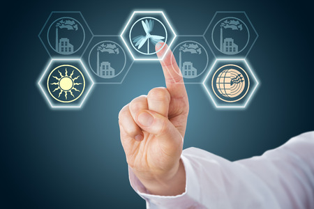 factory power generation: Index finger is selecting renewable energy icons via a virtual interface with hexagonal buttons. The selected symbols for solar, geothermal and wind power are lighting up over a dark blue background. Stock Photo