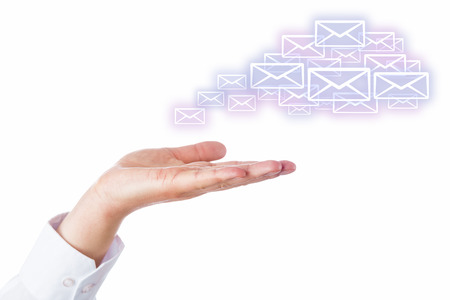synchronizing: Numerous email icons rising from an open palm of a hand to shape a virtual cloud. Business symbol or metaphor for cloud computing. Cutout isolated on white. Artwork space for your smart phone product.