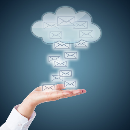 steel blue: Many email icons landing in an open palm. Or rising up from the hand into a receptive cloud computing symbol. Business metaphor for online correspondence and mobile computing. Steel blue background. Stock Photo