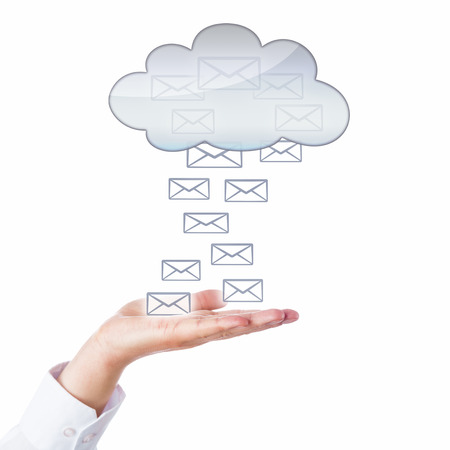 male palm: Several email icons floating between an open male palm and a cloud symbol hovering above. Business metaphor for electronic mail via cloud computing technology. Cutout isolated on white background. Stock Photo