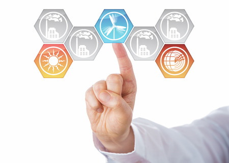 factory power generation: Solar, wind and geothermal power generation icons being chosen by the hand of a business man. Three activated hexagonal buttons lighting up in color, while factory symbols stay grey. Cutout on white.