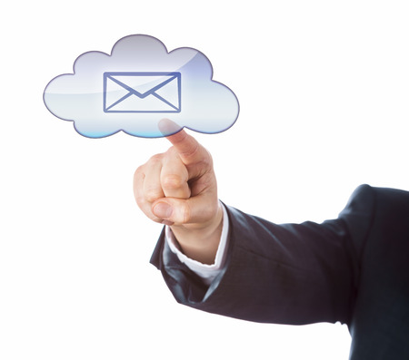 technology metaphor: Cutout of forearm raising an index finger to point at an email icon inside a cloud computing symbol. Business or technology metaphor for mobile computing and instant information access. White ground. Stock Photo