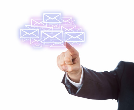 technology metaphor: Arm of a business person aiming index finger at many email icons forming a cloud. Technology metaphor for mobile computing. Transparent touch screen interface. Copy space. Cutout on white background. Stock Photo
