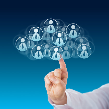 white collar worker: Index finger of a white collar worker touching human resources icons that shape a virtual cloud. Business metaphor for cloud computing and technology service industry. Close up on blue background.