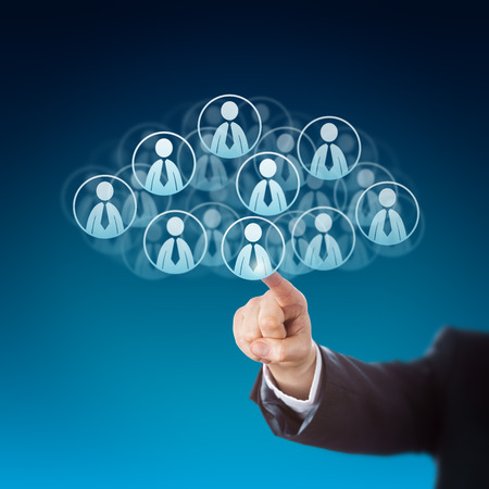 technology metaphor: Forearm of a business person is reaching out to click on human resources icons in the cloud. Many knowledge worker buttons do shape this cloud computing symbol. Technology metaphor. Blue background. Stock Photo