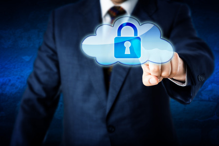 Upper body of a business man reaching out to touch a locked cloud computing icon. Metaphor for information security and protection in cyber space. Corporate suit and blue wall in background. Close up. Stock Photo