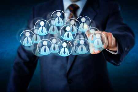 social worker: Torso of a manager in blue business suit selecting white color worker icons in a virtual cloud shaped of many office worker symbols. Technology metaphor combining smart computing and human resources.