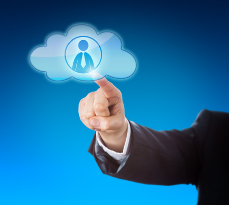 technology metaphor: Arm in dark blue business suit reaching out to point at a knowledge worker icon inside a floating cloud computing symbol. Technology metaphor for resource pooling and smart computing solutions.