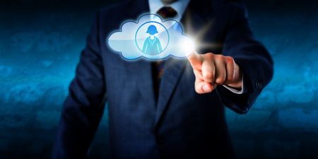 technology metaphor: Upper body of a male manager in blue business suit is touching a cloud icon to connect with a female peer in cyberspace. Technology metaphor for smart computing cloud sourcing and human resources.