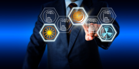 Torso of a business man reaching forward to push a geothermal power button on a touch screen. Wind and solar energy icons are activated also while factory symbols remain grey. Energy turn metaphor.