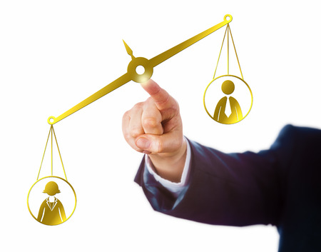 disparity: Arm of a businessman reaching out to touch a virtual pair of balances that weigh a female and a male office worker. The weighing scale is leaning towards the female worker. Career and success theme.