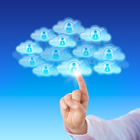 scalability: Index finger of a white collar worker is touching a cloud icon to connect with many peers in cyberspace. Numerous cloud icons with worker symbols do combine to form a single larger cloud shape. Stock Photo