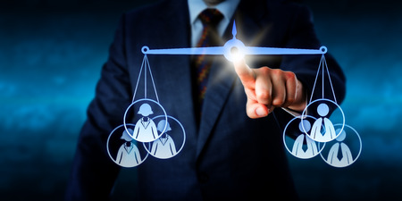 female judge: Torso of a businessman is touching a virtual pair of scales to balance out a female versus a male work team consisting of three knowledge workers each. Business metaphor and gender competition theme.