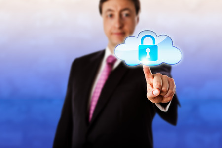 technology metaphor: Gently smiling businessman is reaching forward to touch a locked cloud icon floating in mid-air. Technology metaphor for cloud computing, cyber security, information privacy and authentication. Stock Photo