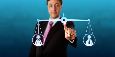 employment issues: Happy businessman is reaching out to touch a virtual pair of scales that is keeping a female and a male office worker in balance. Business metaphor for gender equality, career and employment issues. Stock Photo