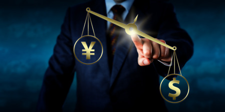 foreign exchange: US dollar outweighing the Chinese yuan renminbi or Japanese yen on a golden scale. Torso of a trader touching a virtual balance. Theme of currency transaction in the modern foreign exchange market. Stock Photo