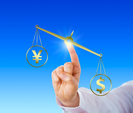 us money: Dollar sign outweighing the yen symbol on a golden equal-arm balance. Stretched index finger of a white collar worker is positioning the virtual weight scale in space. Close up and 2D illustration. Stock Photo