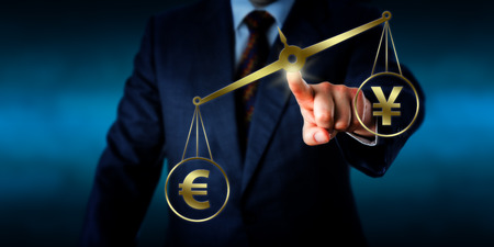 financial metaphor: Torso of a businessman operating a virtual golden scale on which the Euro sign is outweighing the China Yuan symbol. Financial metaphor for global currency transactions and foreign exchange market. Stock Photo