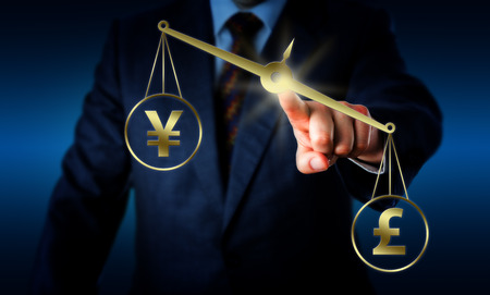 british pound: British Pound Sterling sign is outweighing the Chinese Yuan currency symbol on a golden balance operated by the hand of a businessman. Financial theme of modern foreign exchange market. Stock Photo