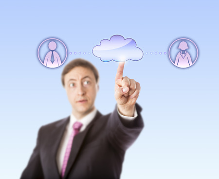 contacting: Business manager is contacting a female and one male team member  by touching a virtual cloud. The cloud is connected via dotted lines to a white collar worker icon on each side. Selective focus.