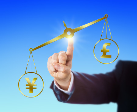 outweighing: Japanese Yen symbol outweighing the British Pound Sterling sign on a golden pair of scales. Right arm of a forex trader is reaching out to touch the balance with his index finger. Clear background.
