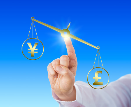 financial metaphor: British Pound Sterling symbol is outweighing the Japanese Yen currency sign on a golden scale. Index finger of a white collar worker is touching the balance. Financial metaphor for forex trading.