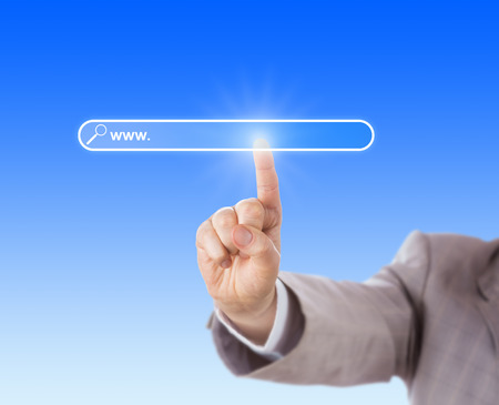Index finger of a businessman is reaching forward to touch a blank search bar of a browser. Do insert your web domain address after the www in the void finder box. Sky blue background. Close up.