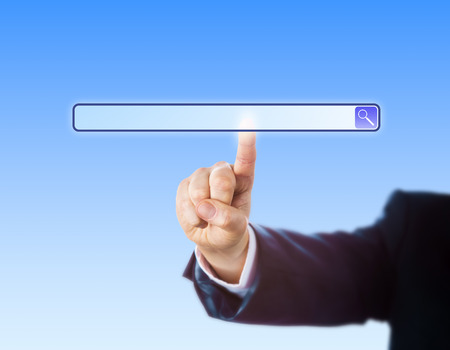 search results: Arm in dark blue suit reaching out to touch a blank search engine tool bar. Insert your own web domain address into the empty type field! Plenty of copy space, sky blue background, close up shot.