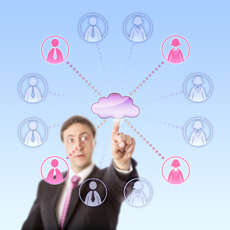 scalability: Gazing business manager is remotely choosing office worker icons via the cloud by touch. Two female and two male white collar workers selected out of a work team of twelve people do light up in pink.