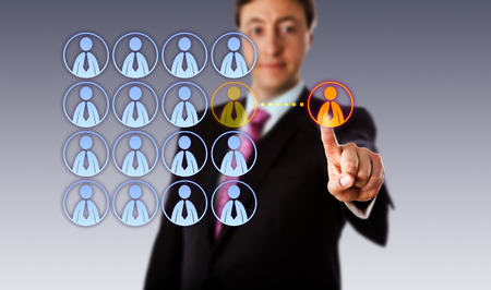 contracting: Smiling manager is touching a single male white collar worker icon outside an organized group of male employee icons. Business metaphor for outsourcing, crowdsourcing, hiring and contracting.