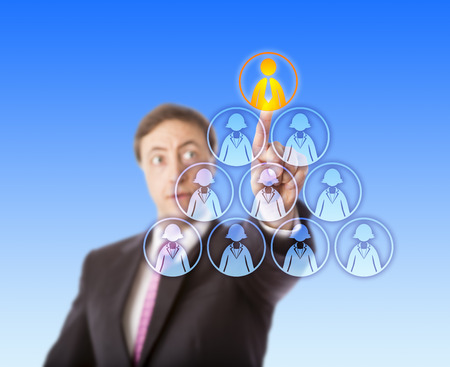 gazing: Gazing business man is singling out the only one male worker icon atop a pyramid otherwise shaped by female white collar workers. Concept for recruiting, headhunting and gender discrimination.