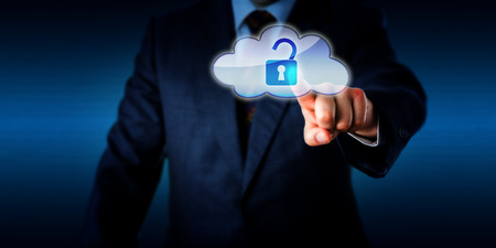 technology metaphor: Torso of a businessman opening a virtual padlock in the cloud via touch. Technology metaphor for cloud computing, information access and network security. Plenty of copy space. Brick wall background.