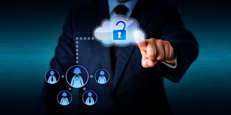 security technology: Torso of a business manager is directing his left hand to unlock a cloud icon by touch, thus opening a connection to a virtual work team of five remote white collar workers. Plenty of copy space. Stock Photo