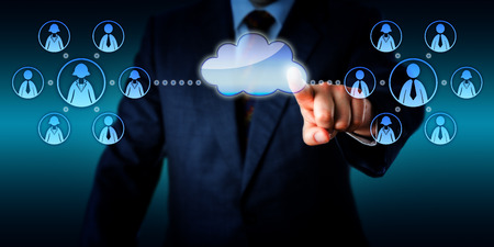 online service: Torso of an IT consultant is connecting two work teams in the cloud via touch.   Stock Photo