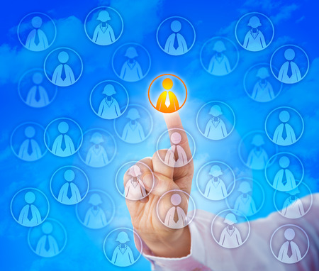 knowledge business: Hand selecting one male knowledge worker in a crowd of virtual employees hovering in cyber space. Business concept for human resources issues, recruitment challenge and the service industry.