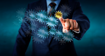Recruitment consultant is selecting a small golden cog wheel embossed with a female worker icon from a host of virtual cogs forming a gear train. Concept for human resources decision and hiring.