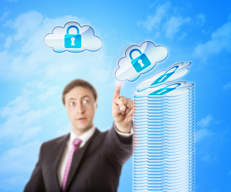 technology metaphor: Authorized looking white collar worker is stacking up encrypted cloud objects forming a secure storage tower. Technology metaphor for cloud security, remote data storage and digital risk mitigation.