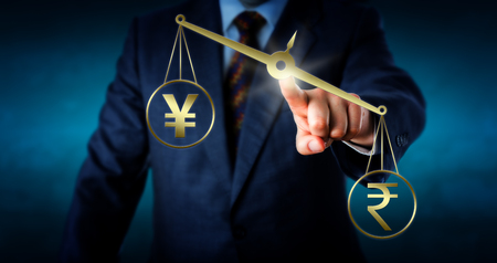 yen sign: Indian rupee currency sign is outbalancing the Japanese yen or China yuan symbol on a golden weighing scale. A trader is touching the center of the lopsided virtual balance. Concept for forex market. Stock Photo
