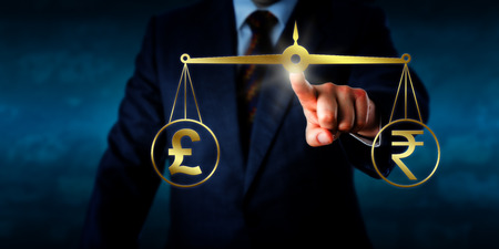 balances: Investor trading the British pound sterling at par with the Indian rupee. A golden pair of balances are keeping the pound sign and rupee currency symbol in equilibrium. Business concept for forex.