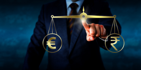 equilibrium: Investor trading the euro at par with the Indian rupee. A golden pair of scales are keeping the euro sign and the rupee currency symbol in  equilibrium. Business concept for foreign exchange market.