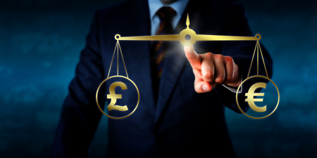 equilibrium: Investor trading the British pound sterling at par with the Euro. A golden pair of scales are keeping the pound sign and euro currency symbol in equilibrium. Business concept for currency exchange.