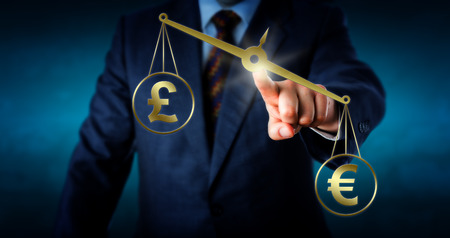 imbalance: Euro currency symbol is outbalancing the British pound sterling sign on a virtual golden pair of scales. Business metaphor for trade imbalance and the modern foreign currency exchange market. Stock Photo