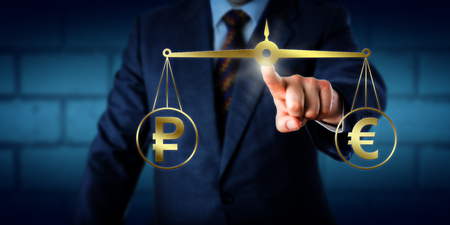 trade: Broker trading the Russian Ruble at par with the Euro. A golden equal-arm balance is keeping the ruble sign and euro currency symbol in equilibrium. Business concept for bilateral trade. Stock Photo