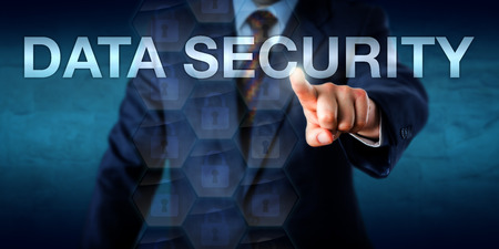 confidential: Businessman is touching the words DATA SECURITY onscreen. Technology and business concept for information security, data confidentiality, access control and computing authentication measures.