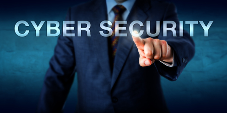security technology: Business manager is touching the words CYBER SECURITY onscreen. Technology concept for computer security and corporate information security. Central text with copy space over blue background. Stock Photo