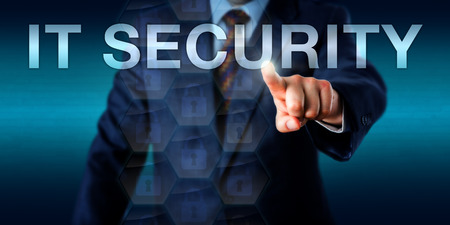 business it: Entrepreneur in business suit is pressing the word IT SECURITY on a touchscreen interface. Technology concept for computer security, IT security, cyber security and protection of computer systems.