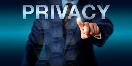 confidentiality: Executive pressing the word PRIVACY on a touch screen interface. Business concept and technology metaphor for information privacy, personal computing and data confidentiality. Plenty of copy space. Stock Photo
