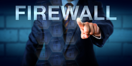 firewalls: Business consultant is pressing the word FIREWALL on a touch screen interface. Technology metaphor for network layers, packet filters, application-layer firewalls or socket filters and sandboxing. Stock Photo