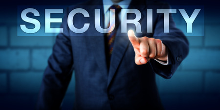 vulnerable: Executive pressing the word SECURITY on an interactive touchscreen. Business concept for security system, protection of any vulnerable asset and resistance to harm. Copy space over blue background. Stock Photo